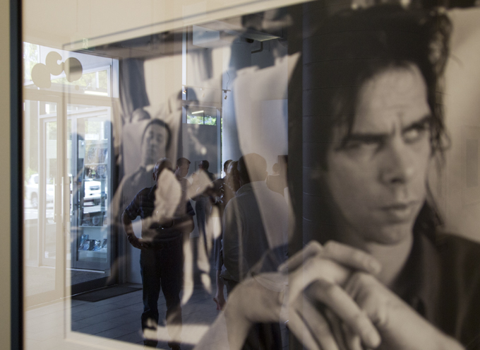 Peter Milne's portrait of Nick Cave reflects visitors to the Treasures show