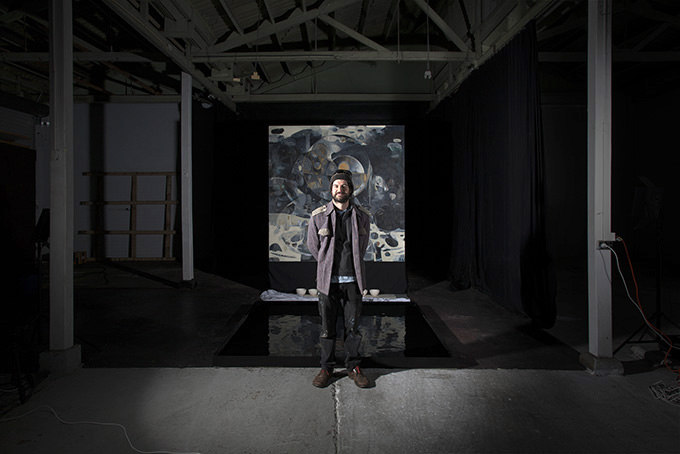 Kamholtz in the performance space with the painting and pool