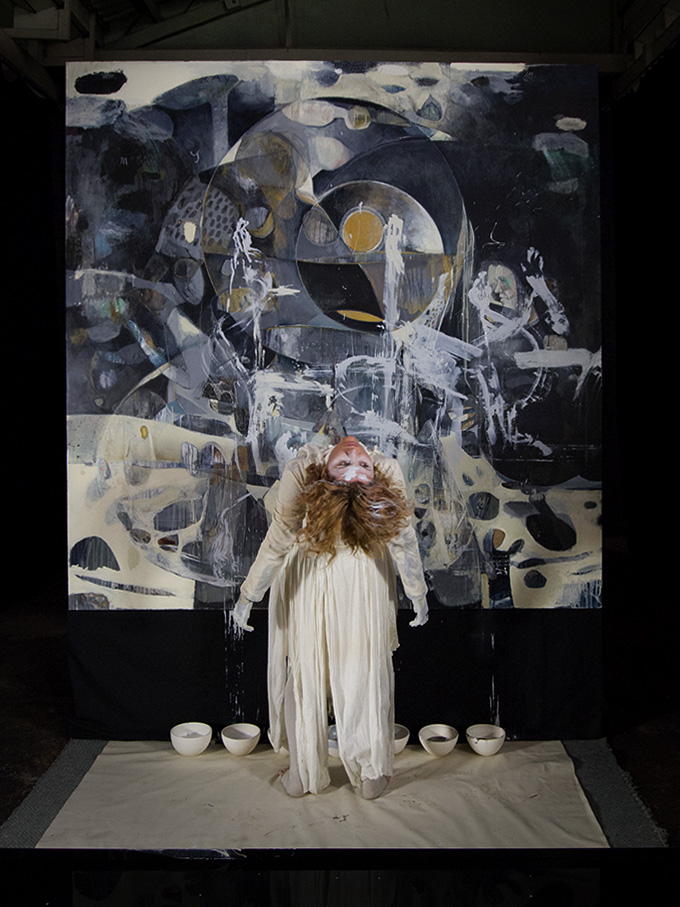 Kirsty Lee and her interaction with the painting   PHOTO Cooper+Spowart
