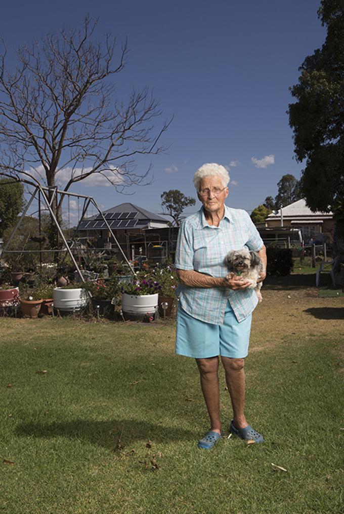 "Joyce Coss 83 years old with ""Waddles"" her Sliky Cross. 63 years living in Warra Warra. Dalby Region. Russell Shakespeare 2013"