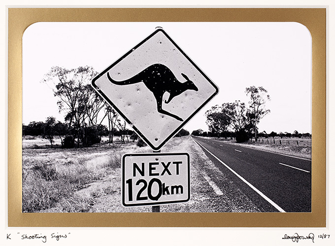 K Kangaroo – An endemic Australian species often so prolific in number that road signs are erected to warn motorists of their presence. The signs are also useful as a test of shooters skill if a shortage of the real thing exists. Judging by this example the Roos have a fair chance. West of Nyngan, New South Wales.