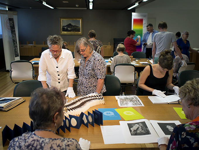 SLQ White Gloves event - Attendees viewing books