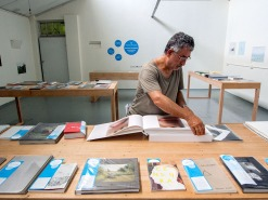 Photobook Melbourne: Peter Lyssiotis looking at an Aperture Books