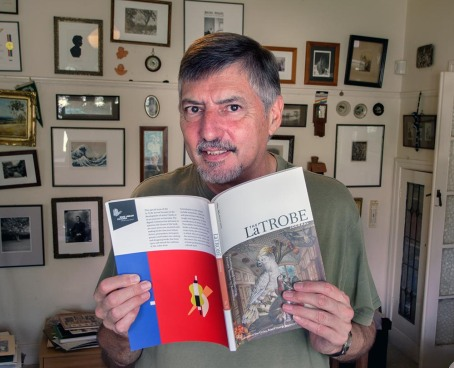 Doug Spowart with the La Trobe journal that features one of his papers on photobooks PHOTO: Victoria Cooper