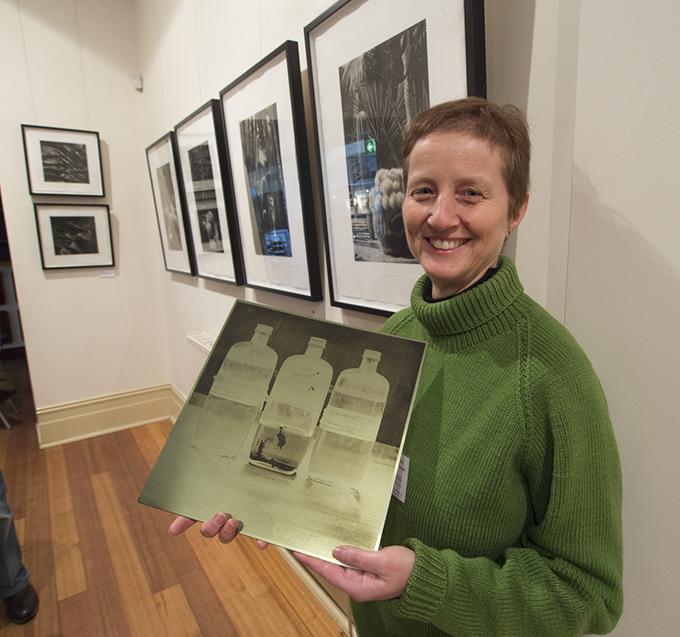 Silvi Glattauer holding a gravure plate of an image from 'Organic Balance'