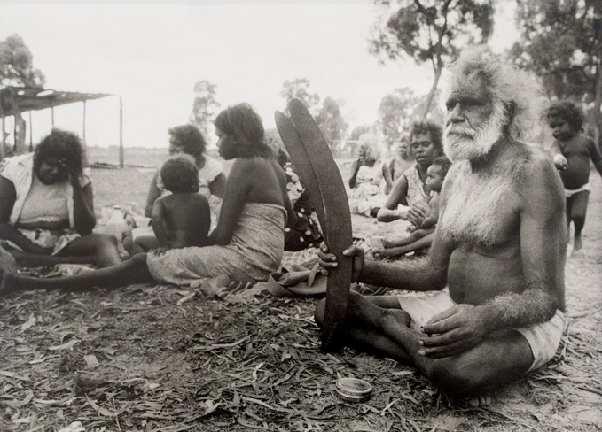 "PHOTO Juno Gemes. ""Lindsay (Spider) Roughsey on the Bora Ground with women of his clan, Mornington Island, 1978"""