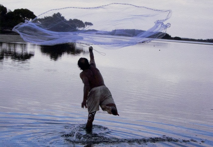 "PHOTO: Michael Aird. ""Paul Wright casting net South Stradbroke Island 2007"""