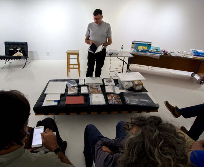 Doug doing a show 'n' tell with examples of their handmade photobooks