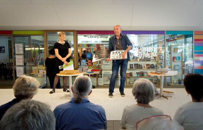 Clyde McGill performing his artists' book Looking for Place