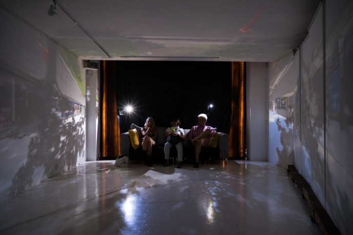 Camera obscura viewers sitting on the couch - note two holes... PHOTO: Louis Lim