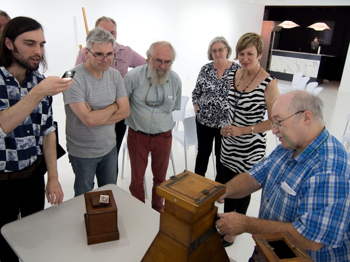 Sandy Barrie demonstrates ancient portable daylight enlargers – the oldest was made before 1859.