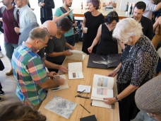 Attendees looking at books