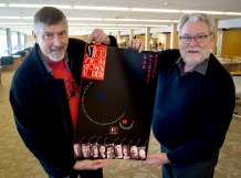 Doug Spowart and Ian Poole with the poster for Shot from down under