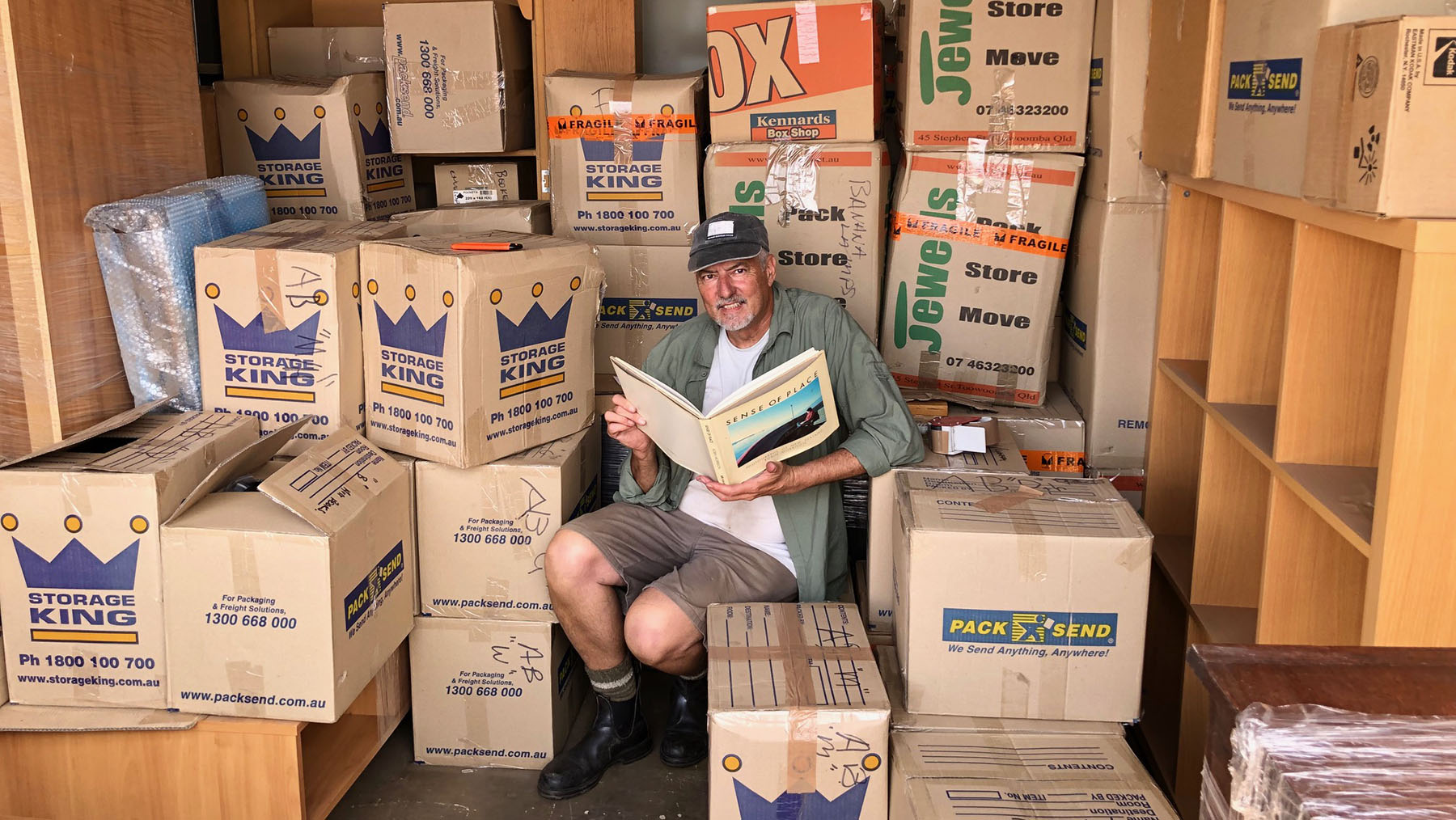 In the storage shed opening boxes looking for books