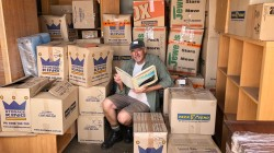 Doug sorting through book boxes