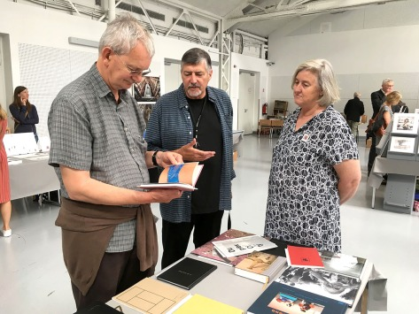 Martin Parr looking at ANZ photobooks at the 2017 Vienna Photobook Festival