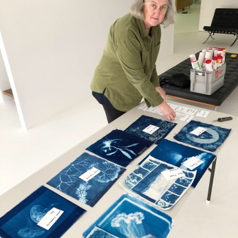 Victoria Cooper unpacking the cyanotype flags