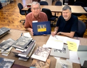 Martin Parr and Doug Spowart reviewing Australian and New Zealand photobooks at the State Library of Victoria for consideration to be included in the Tate submission. January 2018.