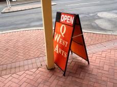 Q-West sign